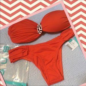 Brazilian cut bikini in deep orange.